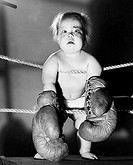 Portrait of a baby wearing boxing gloves