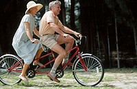 couple on a tandem bike