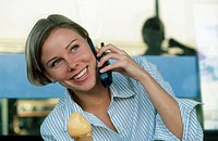 girl eating ice cream on cell phone