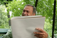 Mature man holding a sketch block