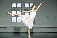 A female ballet dancer doing a arabesque