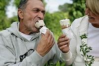 Mature couple eating ice cream