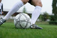 Soccer player kicking a football (thumbnail)