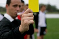 Referee showing the yellow card