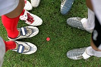 Soccer players standing around a red chip