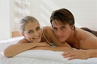 Portrait of a young couple lying on the bed (thumbnail)