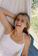 Close-up of a young woman lying in a hammock