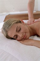 Young woman getting a back massage