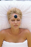 Young woman with a therapeutic stone on her forehead (thumbnail)