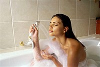 Young woman taking a bubble bath (thumbnail)