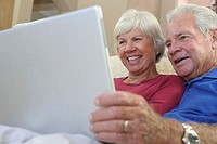 Close-up of a senior couple using a laptop