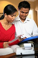Young couple looking at a file