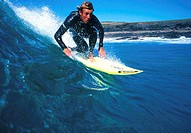Young adult man surfing, Lanzarote, Canary Islands