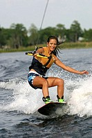 Young adult woman wakeboarding, Florida, USA (thumbnail)