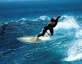 High angle view of a mid adult man surfing in the sea (thumbnail)