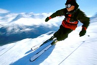 Close-up of a young man skiing
