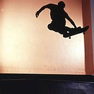 Silhouette of a person skateboarding