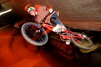 Low angle view of a teenage boy performing stunts on a bicycle