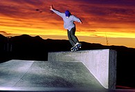 Man skateboarding at dusk