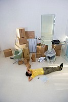 Man lying on floor of new office