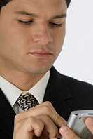 Young businessman using hand held computer, close-up