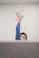 Businessman throwing confetti