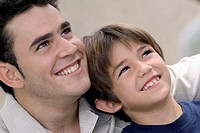 Portrait of smiling boy and man, close-up