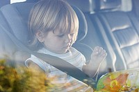 Child sitting in car