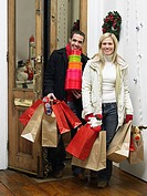 Couple returning home from christmas shopping