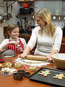 Girl and mother making cookies