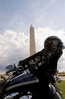 Close-up of a motorcycle parked in front of a monument, Washington Monument, Washington DC, USA