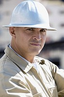Portrait of a construction worker wearing a hard hat