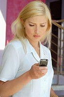 Businesswoman operating a mobile phone