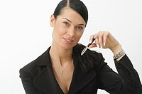 Portrait of a businesswoman holding a pen