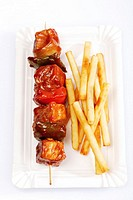 Meat skewer with french fries