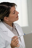 Female doctor holding a chart and pen, close-up