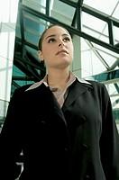Pensive businesswoman looking up