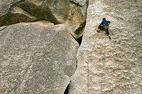 Female climber leading a route in City of Rocks, Idaho, USA