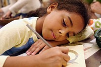 10-year-old biracial girl working on art project at the Cathedral of St. John the Divine, NYC. USA