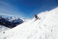 Man skiing downhill, low angle view