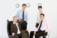 Portrait of four office workers