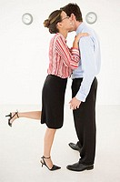 Businesswoman embracing businessman