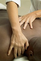 Woman massaging man´s back, close-up, part of