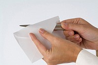 Person´s hand opening letter with letter opener