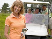 Woman in front of golf cart