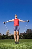 Woman using resistance bands