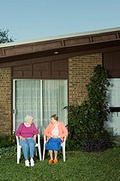 Two senior woman sitting in the garden