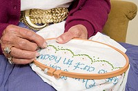 Elderly woman stitching