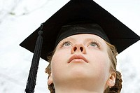 Female graduate looking up