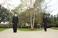 Two female graduates choosing a path